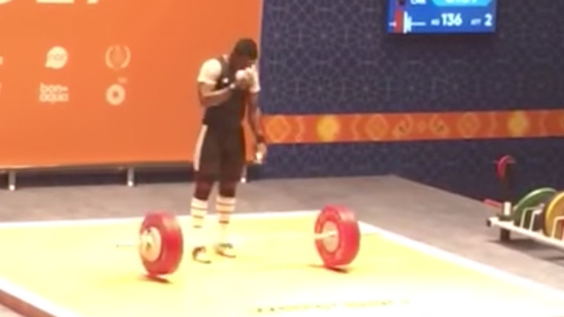 Nothing to get cross about: Cameroon weightlifter makes Christian sign at Islamic Games (VIDEO)