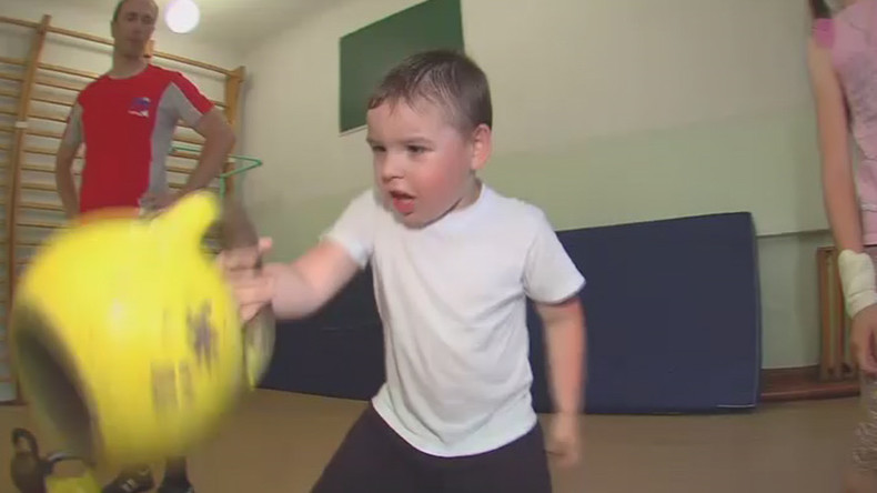 Watch Siberian wonder boy lift heavy weights to dad's delight (VIDEO)