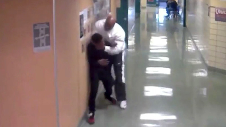 School behavioral specialist lifts teenage student by the neck (VIDEO)