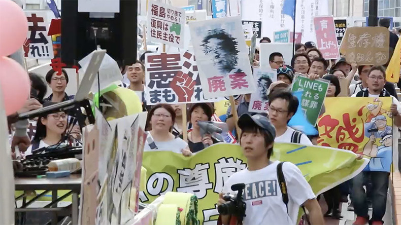 100s of students march in Tokyo against Japanese PM Abe's plans to change pacifist constitution