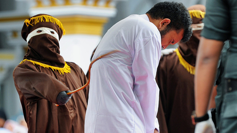 Gay pair caned in Indonesia as crowd cheers & takes pictures
