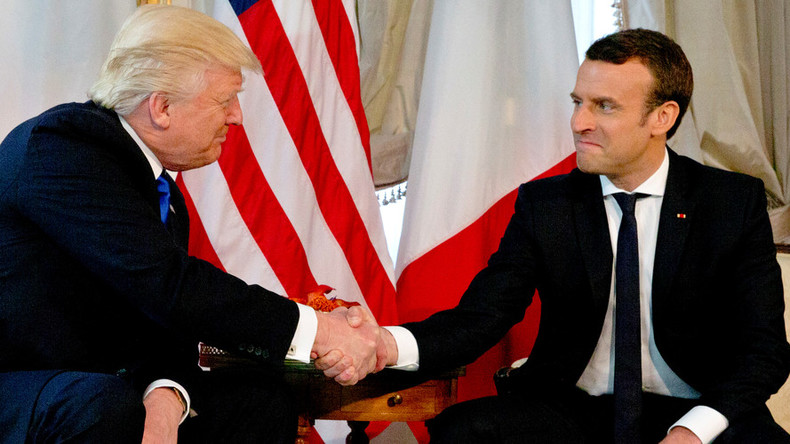 Trump & Macron engage in fierce handshake battle during first meeting (VIDEO)