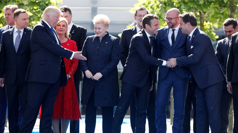 59282434c46188a8698b4583 macron snubs trump for merkel & another arm wrestle follows (video