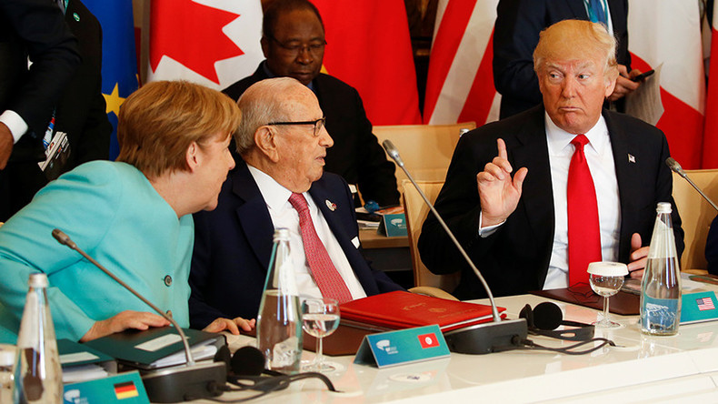 G7 split on climate change, Merkel 'dissatisfied'