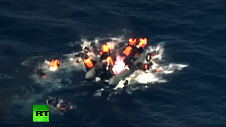 Horrifying moment migrant boat bursts into flames in the Med (VIDEO)