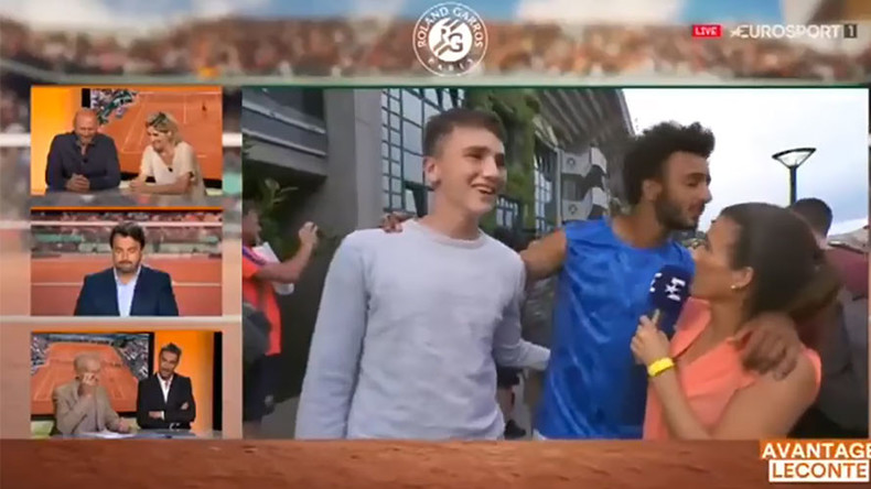 Tennis player banned after forcibly kissing reporter on-air (VIDEO)