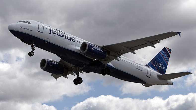 Plane makes emergency landing after laptop battery catches on fire
