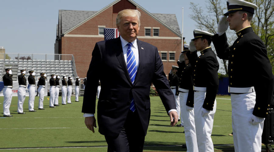 Defiant Trump fires back at 'unfair' media in speech to Coast Guard graduates