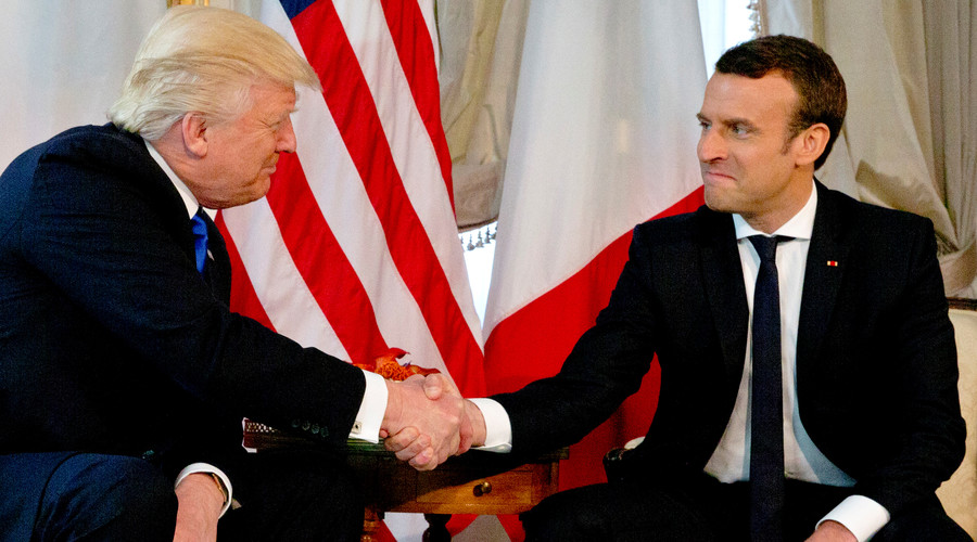 Trump & Macron engage in fierce handshake battle during first meeting (VIDEO)