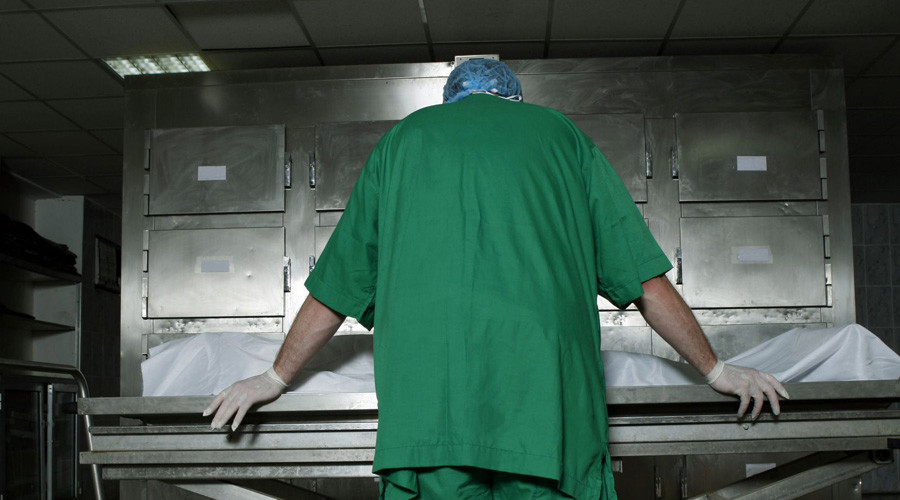 Morgue workers cut open corpse to steal hidden drugs