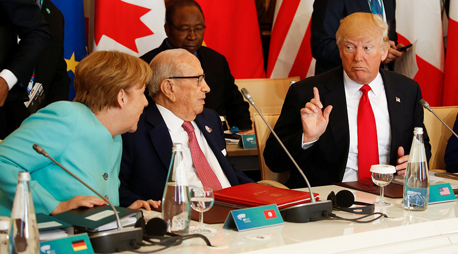 G7 split on climate change, Merkel 'dissatisfied'