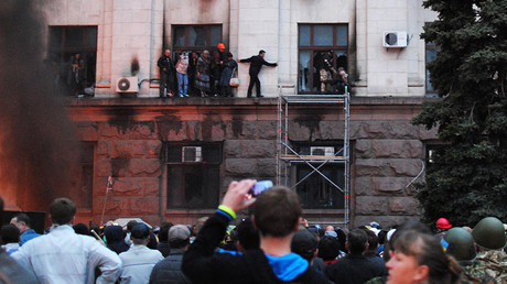 People climbing out on the moulding of Odessa's Trade Unions House during the fire May 2, 2014.