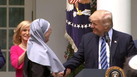 President Donald Trump shakes hands with a nun of the Little Sisters of The Poor during a National Day of Prayer event at the Rose Garden of the White House