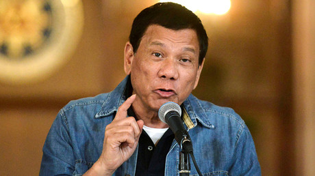 Defiant Duterte withdrawing Philippines from ICC as international tribunal probes his 'war on drugs'