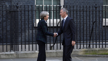Britain's Prime Minister Theresa May greets NATO Secretary General Jens Stoltenberg outside 10 Downing Street in London, May 10, 2017. © Hannah Mckay