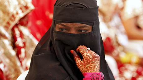 A veiled Muslim bride, India © Amit Dave