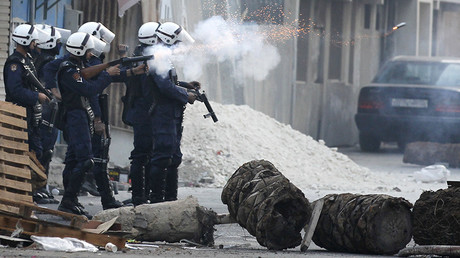 Riot police fires tear-gas at anti-government protester during clashes in the village of Diraz west of Manama, March 13, 2012 © Hamad I Mohammed