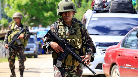 Gunmen take priest, churchgoers hostage in Philippines, vow to kill captives