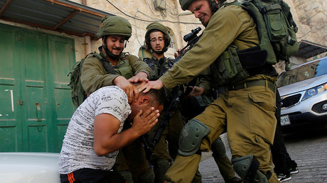 FILE PHOTO: Israeli soldiers detain a Palestinian, West Bank, Hebron. © Mussa Qawasma