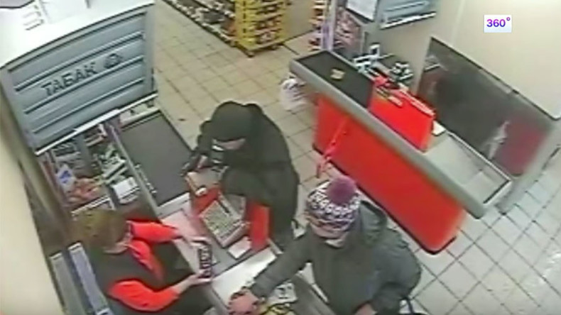 Video of unfazed supermarket staff & customers at gunpoint in Russia goes viral