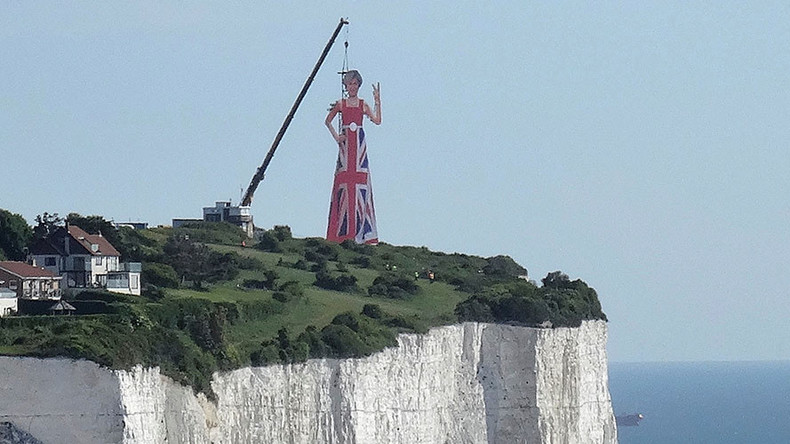 Massive effigy of Theresa May flipping V-sign at Europe erected on White Cliffs of Dover