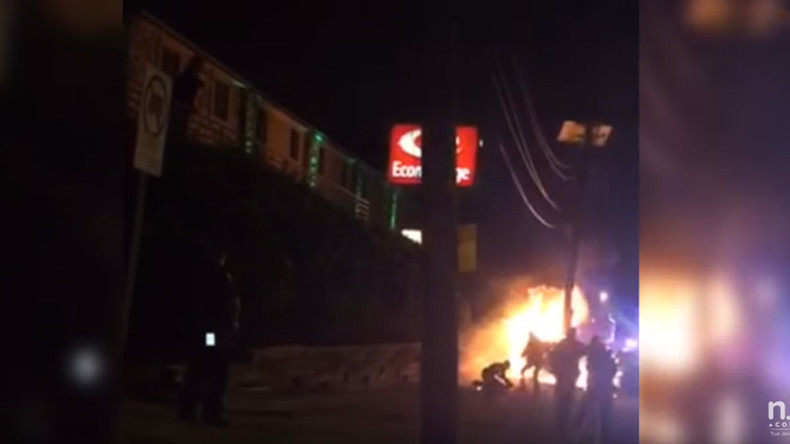 New Jersey cop kicks burning car crash victim in head (VIDEO)