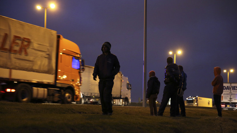 Van driver dies as he crashes into tail-back after migrants set up roadblock near Calais
