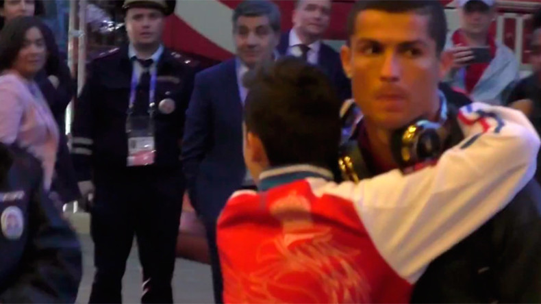Young Ronaldo fan breaks through security to hug his hero (VIDEO)