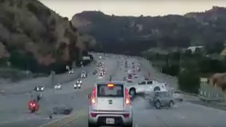Highway road rage leads to fiery wreck after motorcyclist kicks car (VIDEO)