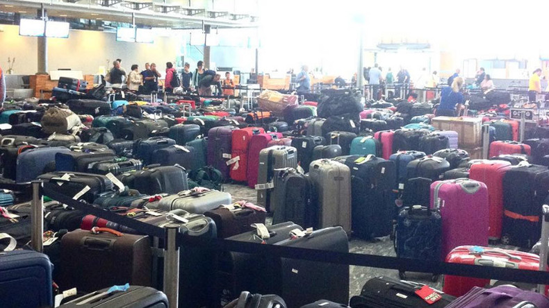 Long lines & chaos as passengers at Oslo Airport forced to abandon luggage (PHOTOS, VIDEO)