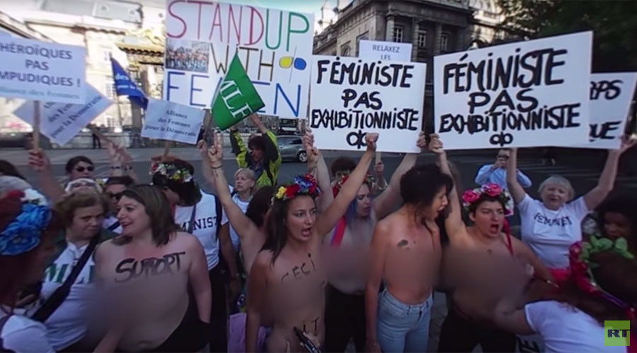 Naked FEMEN activist goes full 'Donald Trump' in Kiev nuclear protest (VIDEO)
