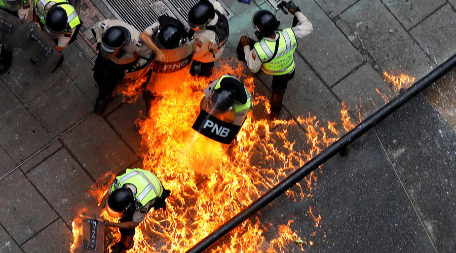 'Burn her alive': US reporter tells RT about death threats from Venezuela opposition protesters