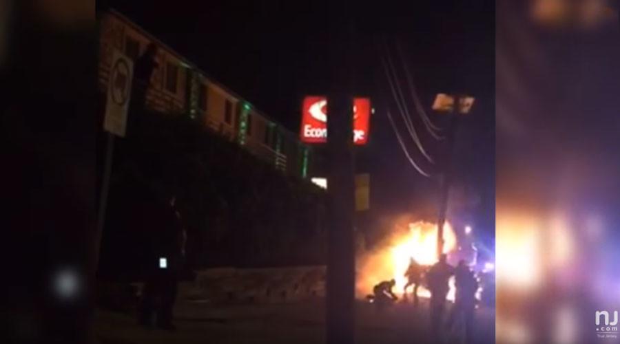New Jersey cop kicks burning car crash victim in head (VIDEO)