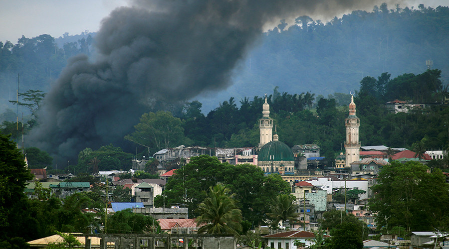 ISIS-linked militants storm school, take hostages in south Philippines village