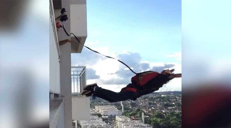 Russian daredevil jumps off high-rise in nail-biting video (VIDEO)