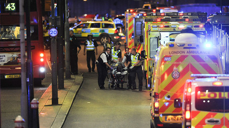Police officers and members of the emergency services attend to a person injured in an apparent terror attack on London Bridge in central London on June 3, 2017 © Daniel Sorabji