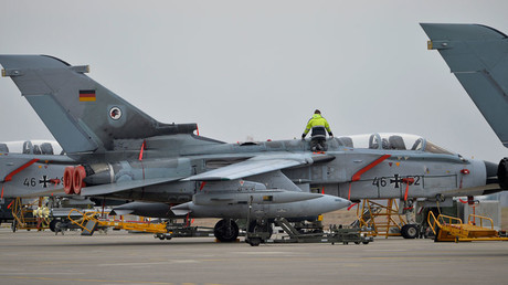 A technician works on a German Tornado jet at the air base in Incirlik, Turkey, January 21, 2016. © Tobias Schwarz