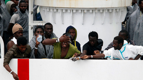 FILE PHOTO: A migrants waits to disembark from Italian Coast Guard patrol vessel Diciotti in the Sicilian harbour of Catania, Italy © Antonio Parrinello