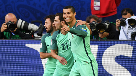 Members of Portugal's national team Cristiano Ronaldo and Cedric Soares and celebrate a score during the 2017 FIFA Confederations Cup match between Russia and Portugal. © Grigoriy Sisoev