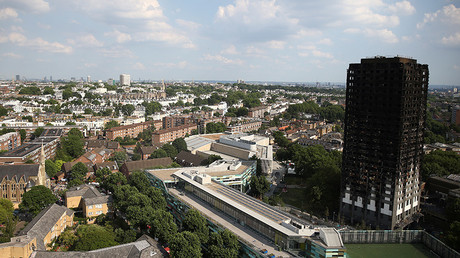 The burnt out remains of the Grenfell apartment tower are seen in North Kensington, London, Britain, June 18, 2017. © Neil Hall