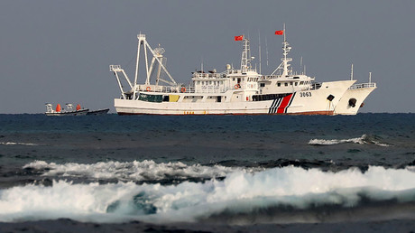 FILE PHOTO: China Coast Guard vessels © Erik De Castro