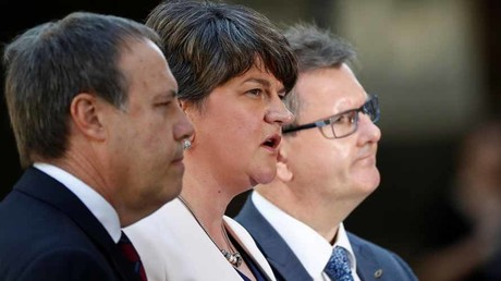 Democratic Unionist Party Leader Arlene Foster, alongside Deputy Leader Nigel Dodds and Chief Whip Jeffrey Donaldson speaks outside 10 Downing Street, in central London © Stefan Wermuth