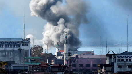 An explosion is seen after a Philippines army aircraft released a bomb during an airstrike in Marawi city © Jorge Silva