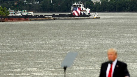 A coal barge sits off in the distance as U.S. President Donald Trump © John Sommers II