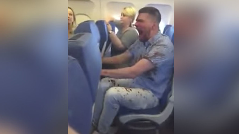 Bloodied man tied up by passengers after fear of flying leads to extreme drunkenness (VIDEOS)