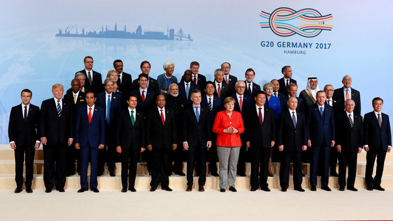 Not so close? Trump further from center than predecessor Obama for G20 family photo