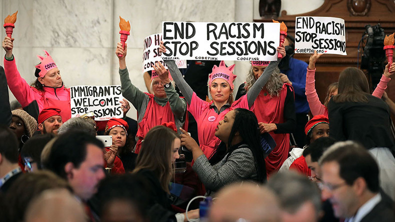 Judge tosses out jury conviction of protester who laughed at Jeff Sessions