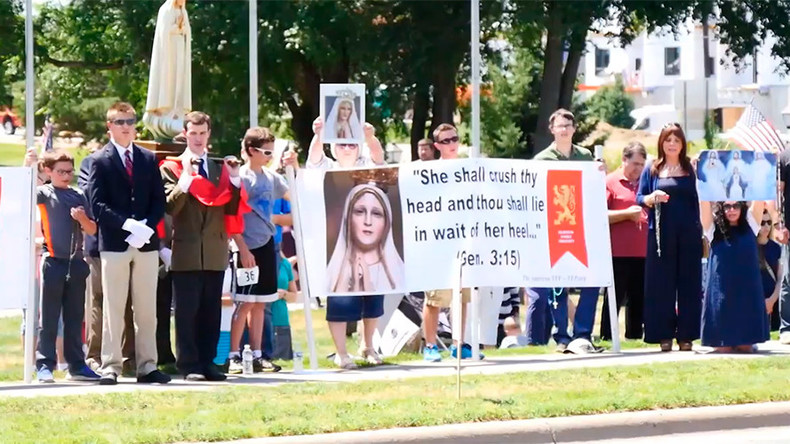 'Honk against Satan!': Hundreds of Catholics protest Satanic statue in Minnesota (VIDEO)