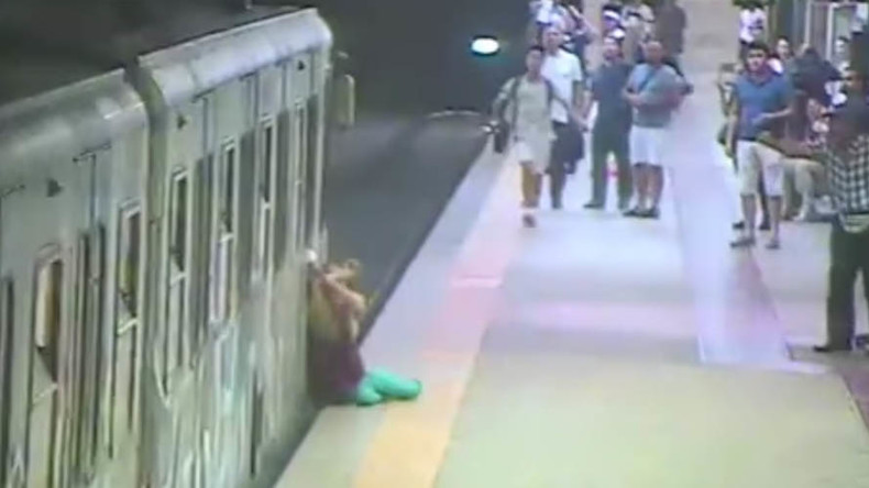 Spine-chilling moment woman caught in metro door & dragged through subway (VIDEO)
