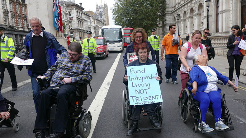 Protesters in wheelchairs block MPs' entrance to Parliament